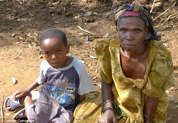 His mother (right) discovered Mukisa (left) bloodied and dying in a bush where the witch doctor had left him, after castrating him at his shrine