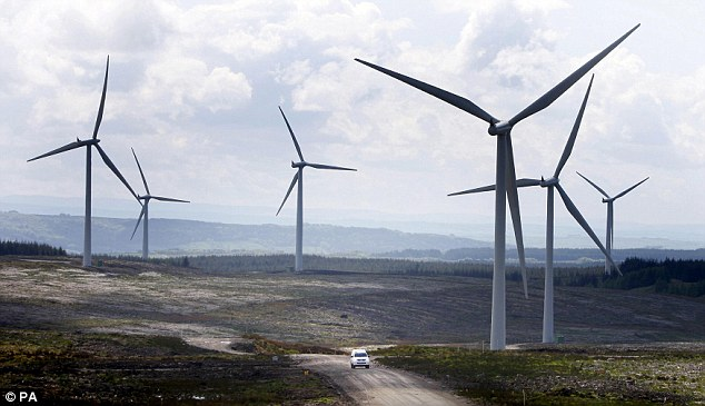 Powers: The Tories have vowed to 'halt the spread' of unsightly turbines by preventing wind farms from being 'imposed on communities without consultation or public support'. A wind farm in Scotland is pictured above