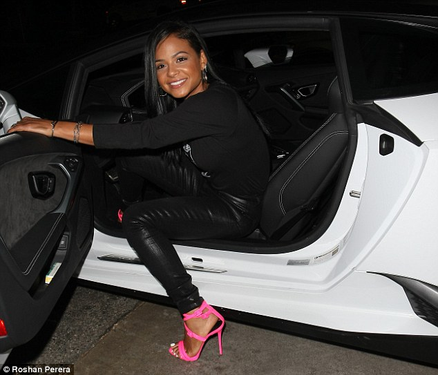 Dip It Low: Christina wore her silky black hair poker straight as she relished in the attention, posing for pictures alongside her luxury ride