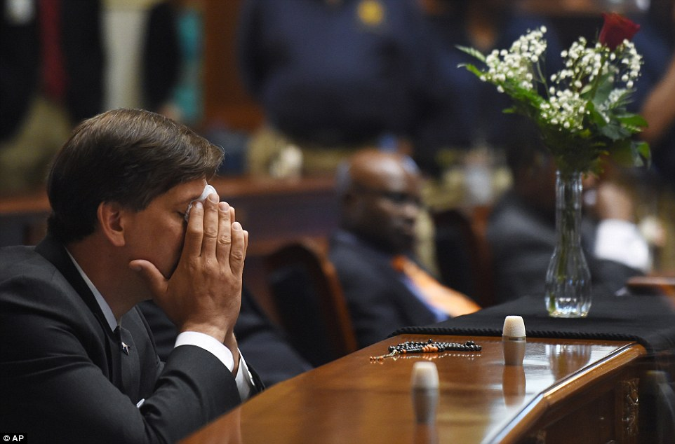 Emotional: State Senator Vincent Sheheen gets emotional as he sits next to the draped desk of state Senator Clementa Pinckney