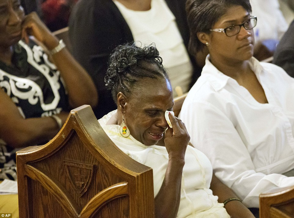 Heartbroken: A parishioner wipes her eye during the memorial service at Morris Brown AME Church