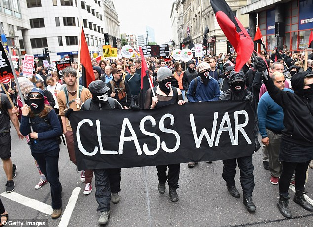 Hundreds of protesters carried banners through London streets including one (pictured saying 'class war'