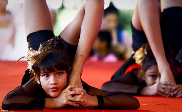 Yoga students from India perform onstage on the occasion of the first International Day of Yoga in Bangkok, Thailand