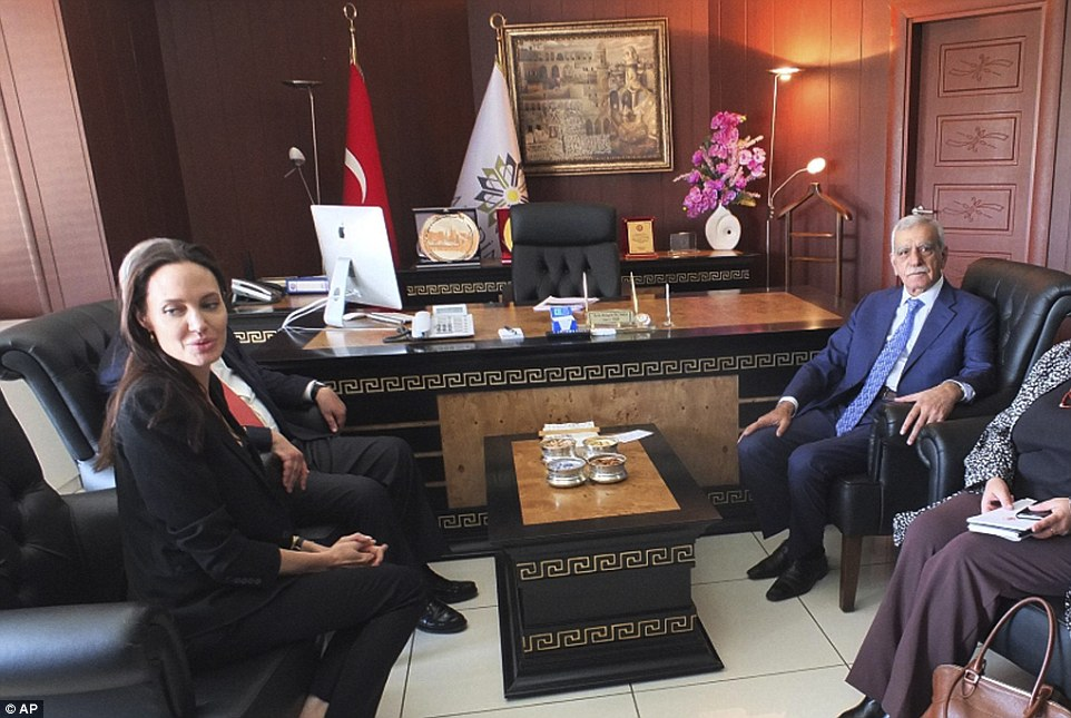 Jolie, left, meets Ahmet Turk, the mayor of the city of Mardin, southeastern Turkey to discuss refugee camps