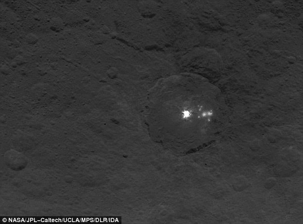 This imagereveals the bright spots in greater detail. Several spots can be seen next to the largest bright area on the left, estimated to be six miles (9km) wide