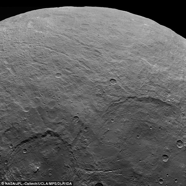 This image reveals the multitude of craters and lines strewn across the surface of this world, located in the asteroid belt between Mars and Jupiter