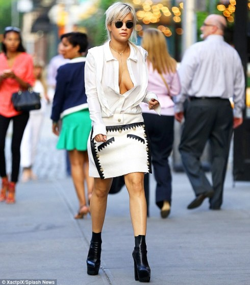 Flashing the flesh: The singer showcased a lot of cleavage in her very low-cut white shrit