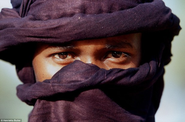 Mysterious: A Tuareg man in a traditional indigo veil, which is likely to leave his face with a blue mark across his skin