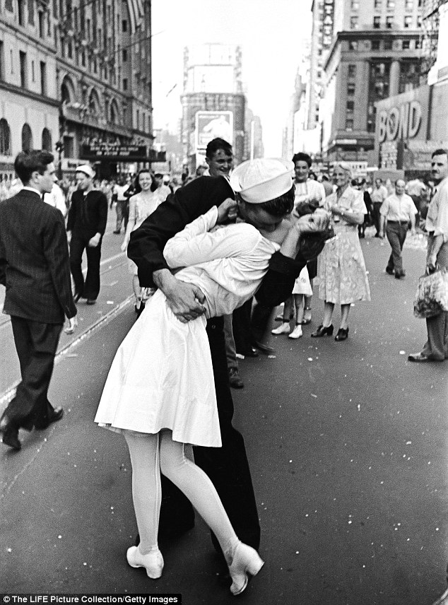 The famous embrace: On 14 August 1944 a sailor and a woman locked lips, but who were they, and when did they kiss? To answer that question, researchers have re-analysed the image (shown). Looking at the clock in the 'O' of 'Bond' on the right, and the shadow on the building top right, they say it happened at 5.51pm
