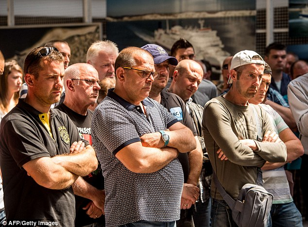 On strike: Employees of cross-channel ferry company My Ferry Link listen to an address by union leaders in Calais a day after their strike triggered severe transport disruption at the French port