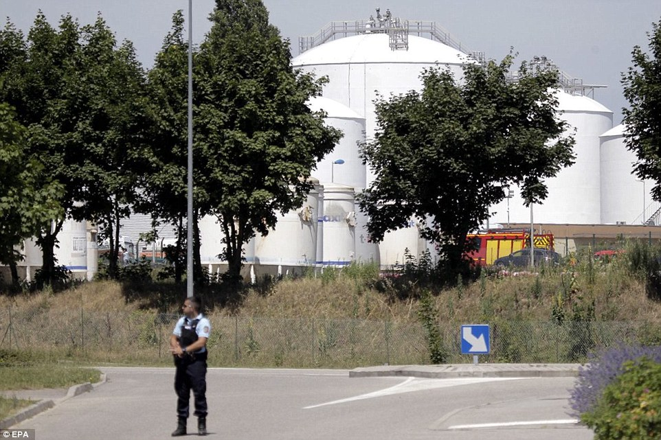 Emergency personnel work at the scene of a suspected Islamist attack, outside a factory in Saint-Quentin-Fallavier in southern France