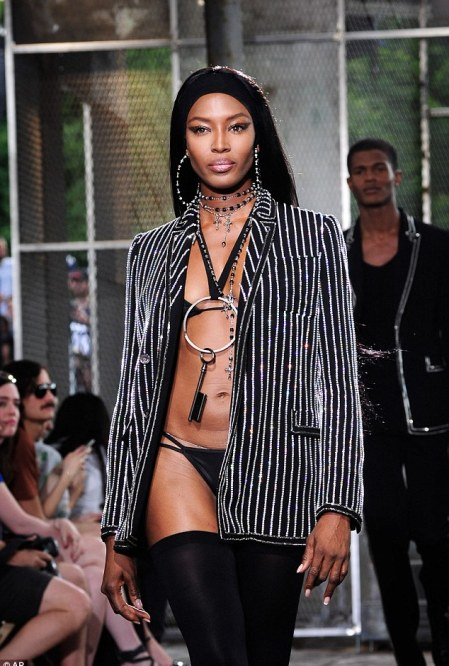 Rocking it: The model wore a bejewelled blazer to cover up her incredible figure