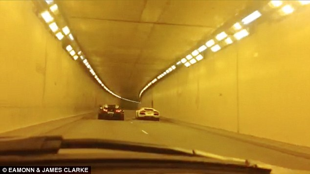 Dead heat: The two supercars pull in front of the camera car - which was travelling at 50mph