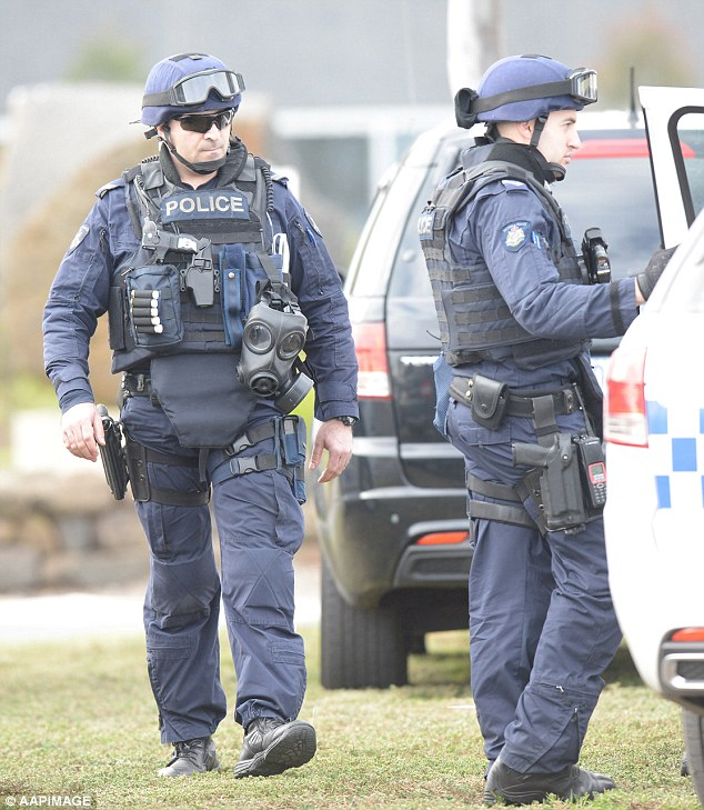 Dangerous situation: Critical Incident Response team members patrol outside the centre