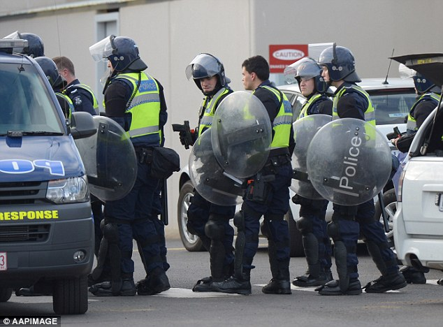 Pushing back: Riot police at the Ravenhall Prison in Melbourne