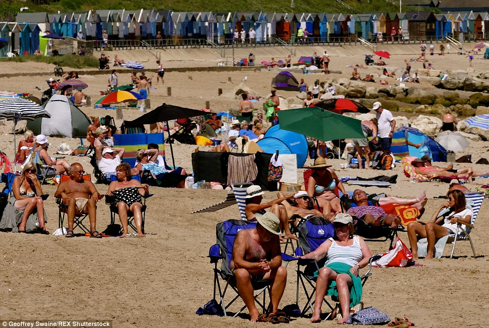 Holiday hotspot: Sun-seekers flocked toAvon Beach near Mudeford Quay in Dorset to lap up the rays which will last until Sunday