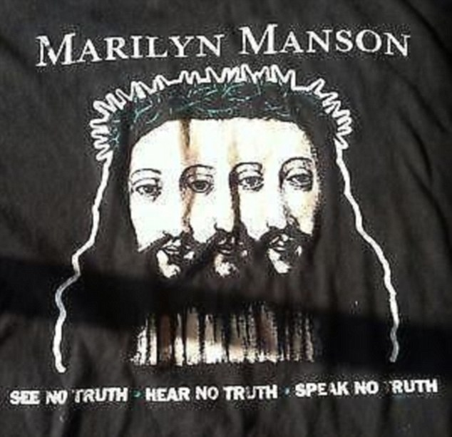Sacrilegious: Emblazoned with a three-faced Jesus wearing the crown of thorns, the shirt reads: 'See No Truth, Hear No Truth, Speak No Truth'