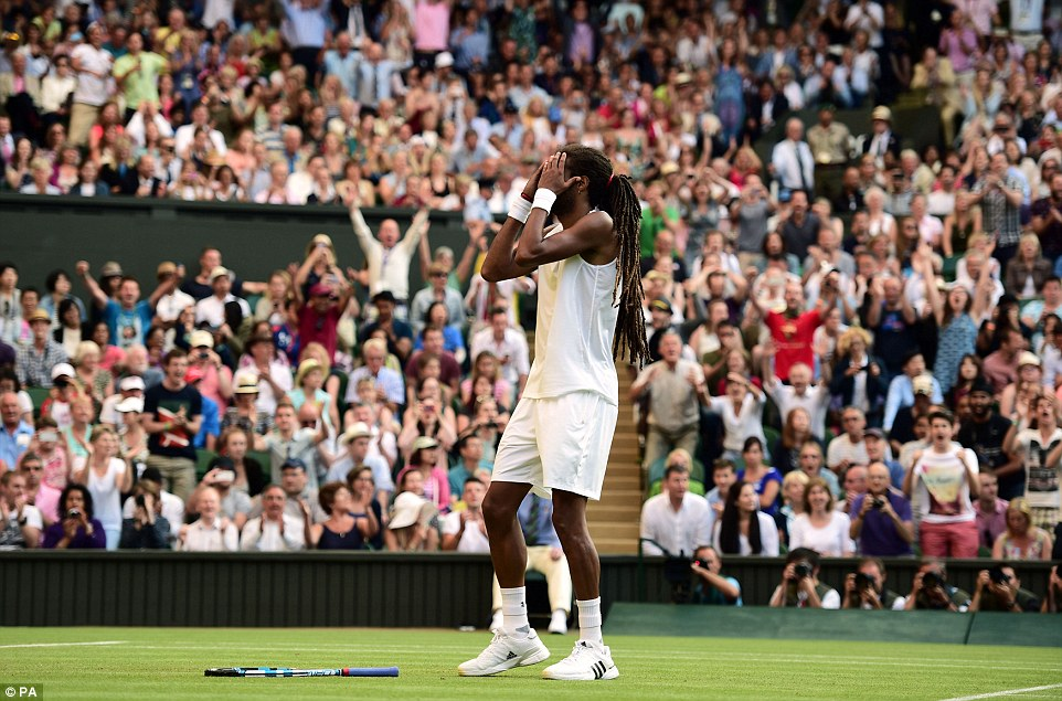 The German celebrates after overcoming the two-time Wimbledon champion as the Centre Court crowd cheers with delight in the background