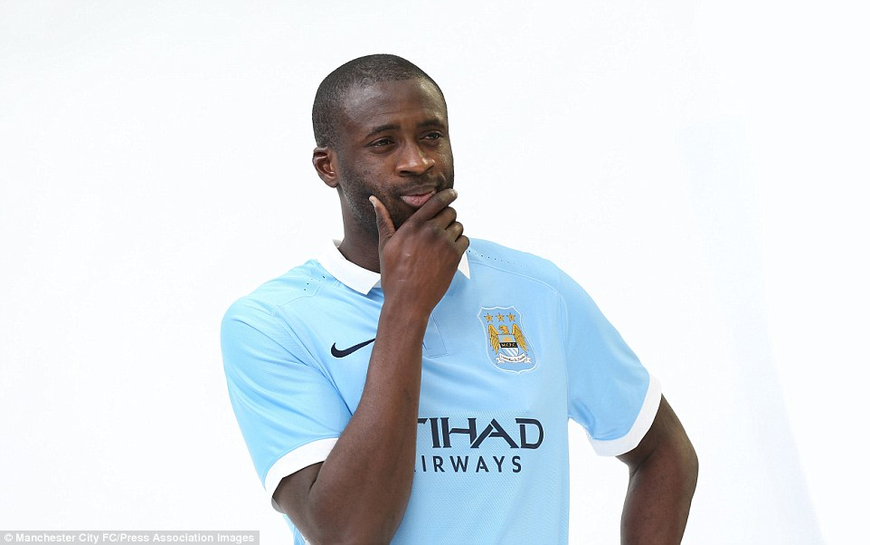 Yaya Toure wears Manchester City's new 2015-16 home kit, which features a white collar and white strips around the sleeves