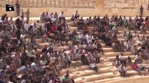 Blood-thirsty: A baying crowd of men and boys gathered in the amphitheatre to watch the 'spectacle'