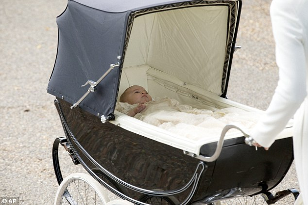 Princess Charlotte looked relatively peaceful and awake lying in the pram as her mother pushed her to the church for her christening