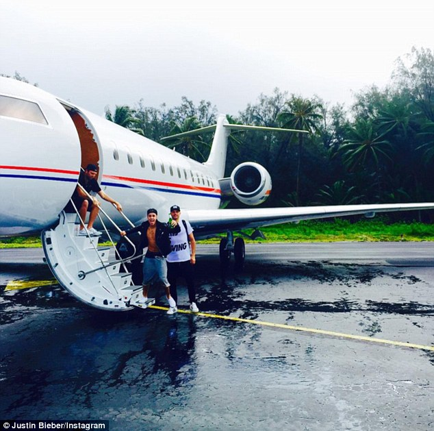 Let loose: Justin posted a photo of himself holding a bottle beer before boarding a private jet on Saturday with Joe andhis spiritual adviser, Pastor Joel Houston