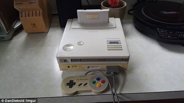 Hybrid: Gamer Dan Diebold reportedly found the device at his dad's house in Philadelphia. It could be an abandoned prototype for a joint venture between Sony and Nintendo to make a console that plays cartridges and CDs