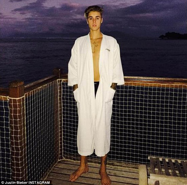 Relaxing getaway: The 21-year-old is currently in Bora Bora, having travelled there from Australia where he spent the Fourth of July (pictured)