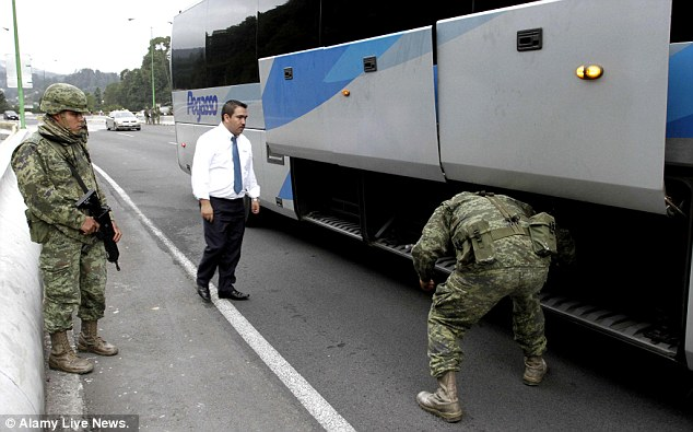Search goes on: Mexican soldiers check a coach at a tollbooth of Mexico-Toluca highway, in Mexico City