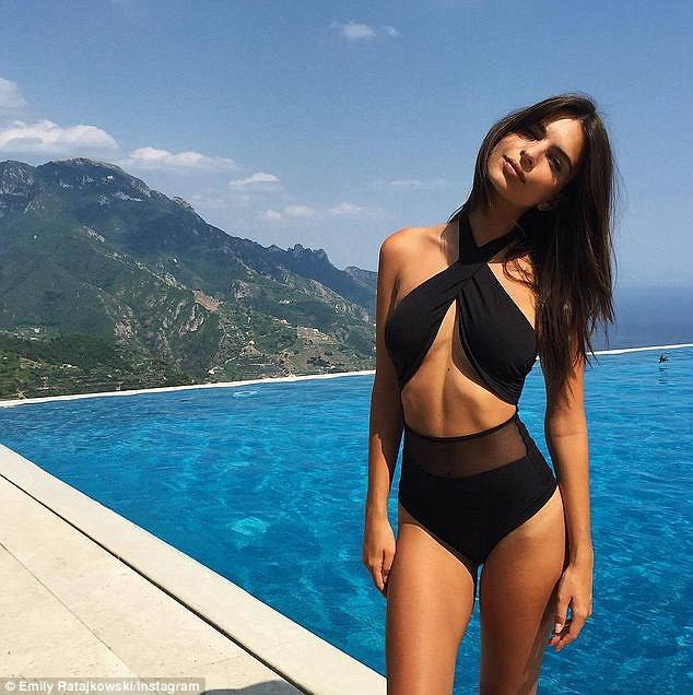 Front view: The 24-year-old looked amazing in the halter-neck cut-out sheer panel swimsuit