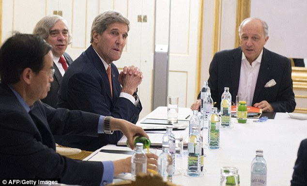 Historic breakthrough: US Secretary of State John Kerry (second right), US Secretary of Energy Ernest Moniz (third right) and French Foreign Minister Laurent Fabius (right) meet at the Palais Coburg Hotel in Vienna, wherea deal aimed at ensuring Tehran does not acquire a nuclear bomb has been struck