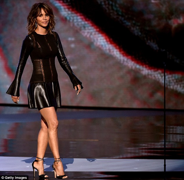 Now that's an entrance: No one could take their eyes off the saucy actress as she walked on stage