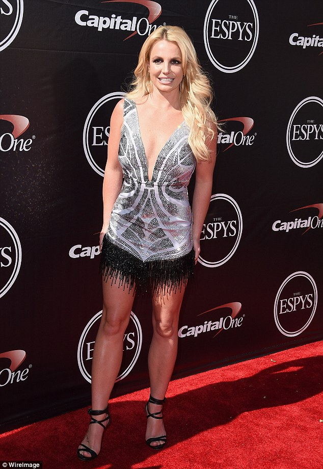 Flashing the flesh! Britney Spears showed off her toned shape in a plunging tank top and beaded shorts at The ESPYS on Wednesday in Los Angeles