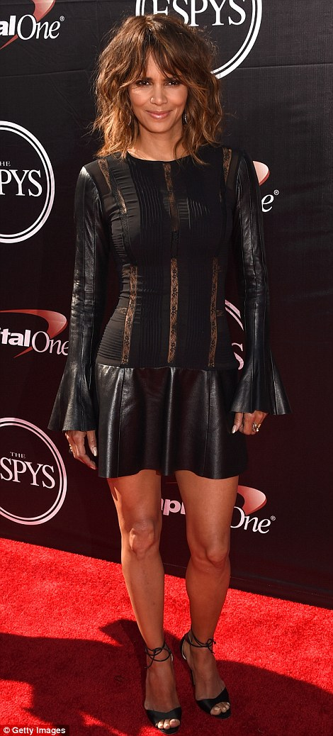Witch dress shall I wear: Halle Berry chose what could have been a sorceress inspired frock which featured bell cuffs in leather and lace panels
