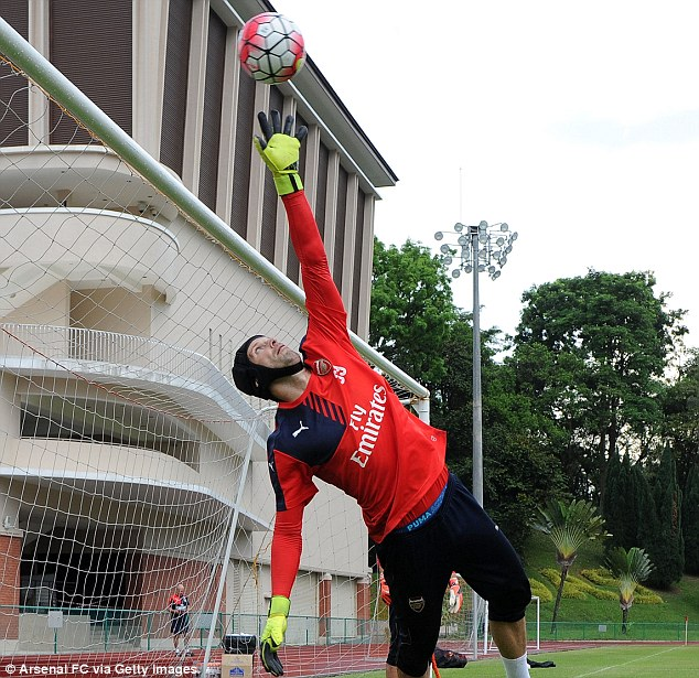 Cech is tested to the max as the former Chelsea goalkeeper is forced to stretch high to tip a ball over the bar