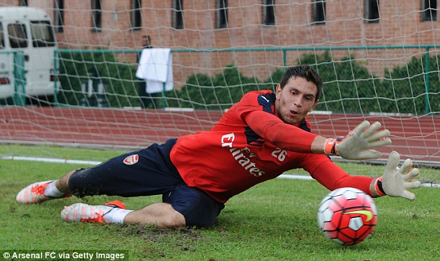 Emiliano Martinez gets both hands behind the ball as he producers a smart save during an Arsenal session