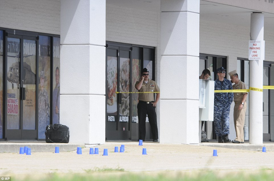 Cordoned off: Personnel stand outside the recruitment center attacked by muslim gunman Muhammad Youssef Abdulazeez