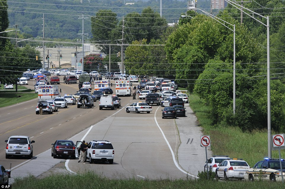 Double shooting: Police and emergency vehicles block Amnicola Highway after the morning shooting near the Naval Reserve Center, in Chattanooga, Tenn. on Thursday, July 16, 2015