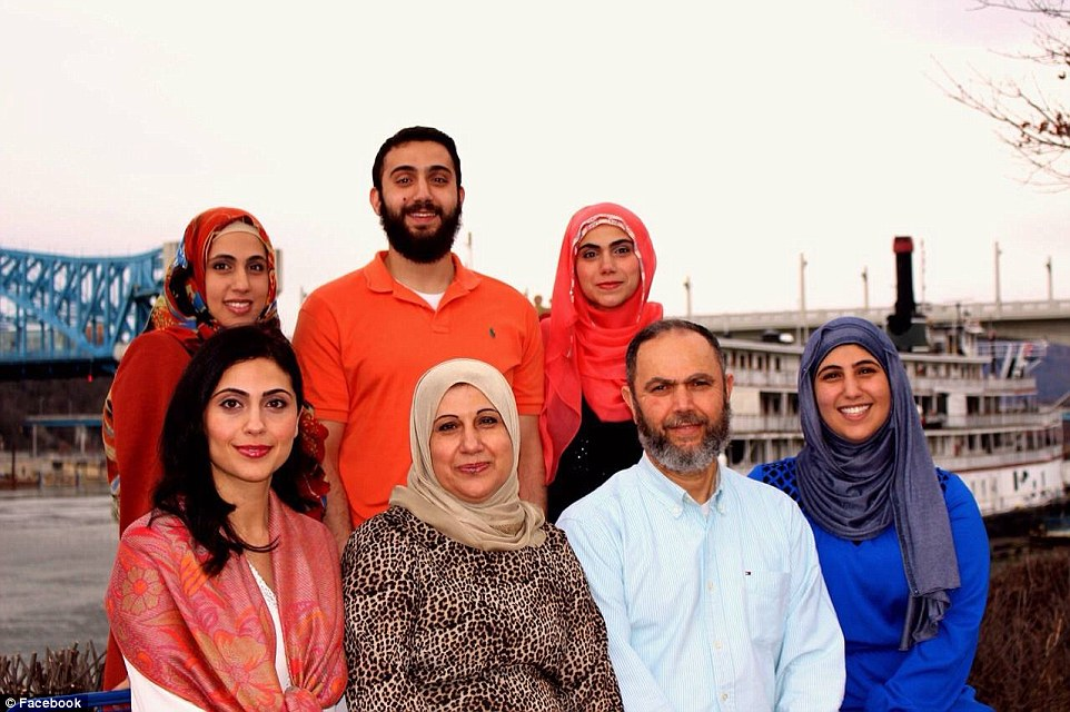 Family: Muhammad Youssef Abdulazeez (back row in the orange shirt) poses for a picture with his family by the river banks of Chattanooga