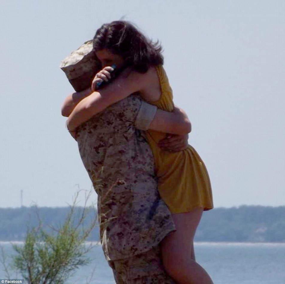 Lance Cpl Skip Wells is pictured above with a woman who appears to be his girlfriend, taken around the time of his boot camp graduation last yearb