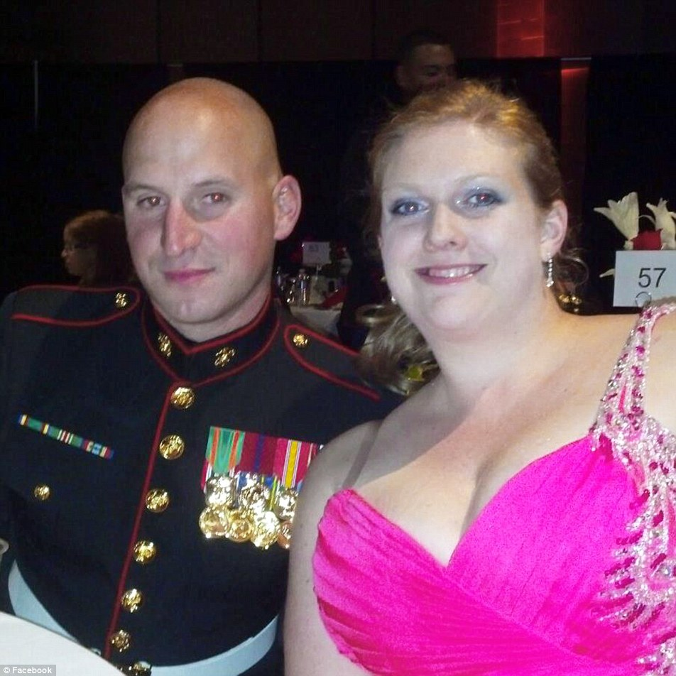 Loved: Staff Sgt David Wyatt pictured above attending a formal event with his wife Lorri in a photo posted to Facebook
