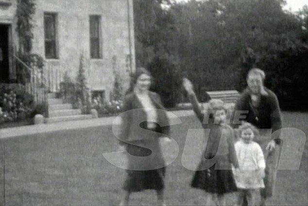 Family film: Edward VIII, long accused ofbeing a Nazi sympathiser, is said to be shown in the footage teaching the salute to the two young sisters. However, a lip reading expert has denied the claims, saying the girls are being asked to wave