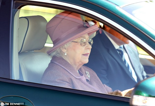 The monarch looked content as she drove her green Jaguar X Type down the Long Walk from Windsor Castle earlier yesterday amid a furore over leaked footage of her as a child