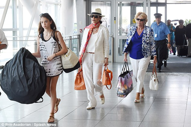 Three generations: Catherine Zeta Jones (centre) was joined by her beautiful daughter Carys, 12, and glamorous mother Patricia at JFK airport on Sunday