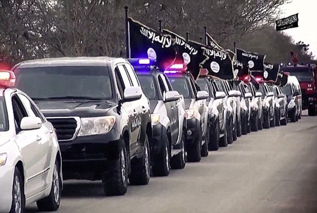 Territory: ISIS is thought to control some territory in Libya and in February, a video appeared to show cars carrying the notorious black flag of Islamic State (pictured) as they drove through the country