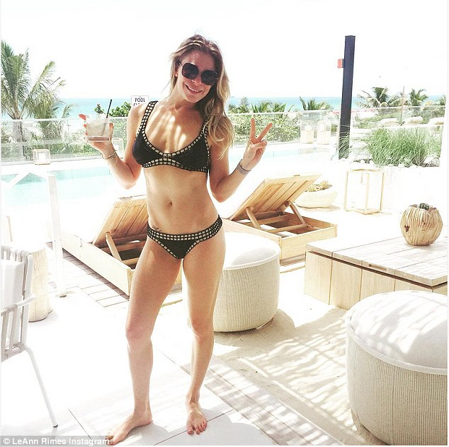 Kicking back! LeAnn Rimes showed off her trim figure in a stylish Kiini swimsuit as she continued to enjoy Miami Swim Week on Monday
