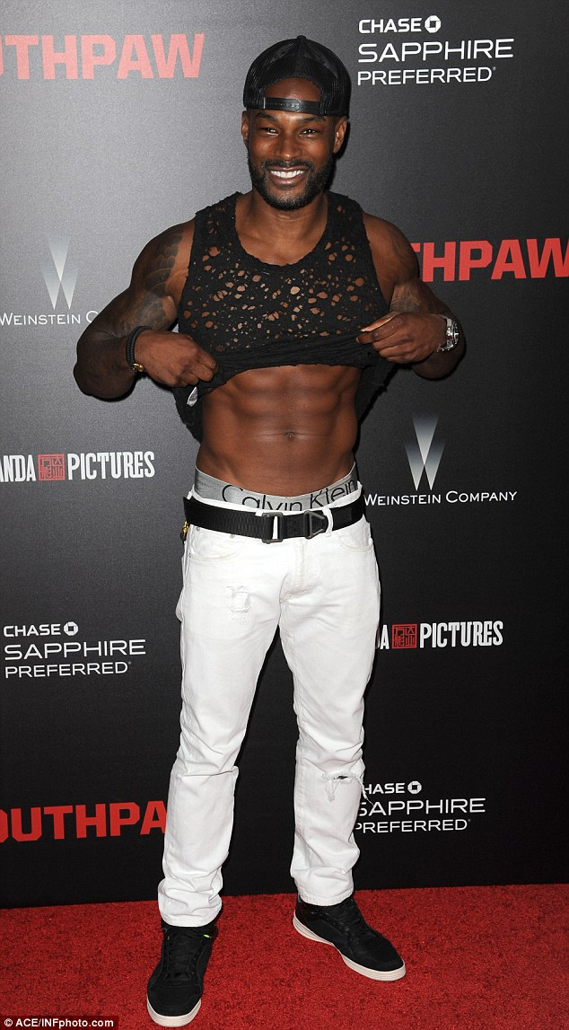Ripped is right! The Chocolate City stud was casually dressed in a distressed tank top, white jeans, and black plimsolls selected by his stylist Ty-Ron Mayes