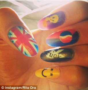 More is more: Nicki Minaj, right, matches her nail art with her diamonds while Rita Ora, left, opts for fun designs