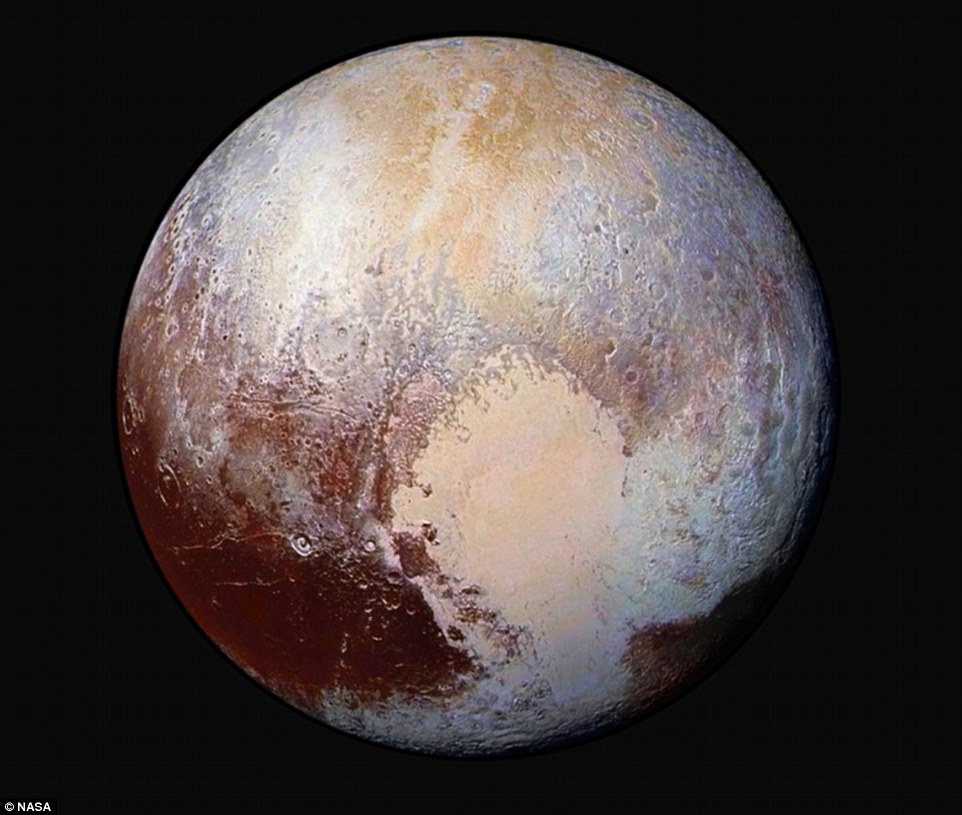 Four images from New Horizons' Long Range Reconnaissance Imager were combined with colour data from the Ralph instrument to create this enhanced colour global view of Pluto. (The lower right edge of Pluto in this view currently lacks high-resolution colour coverage). The images, taken when the spacecraft was 280,000 miles (450,000km) away, show features as small as 1.4 miles (2.2km)