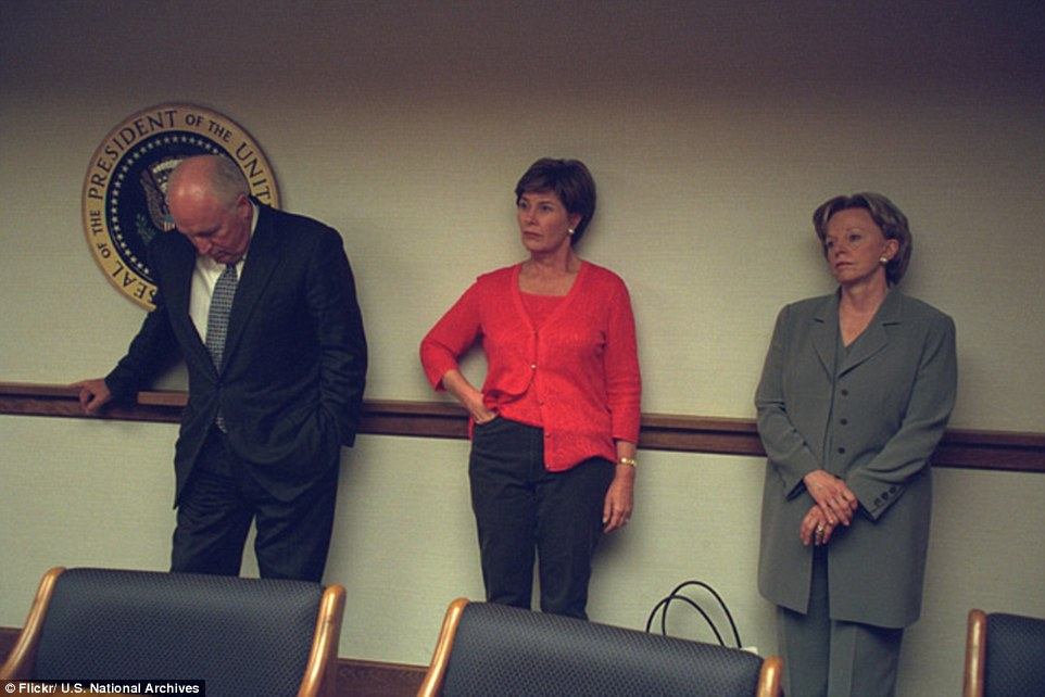 Secure room: Cheney, his wife and then-First Lady Laura Bush (center) all look visibly tense as they stand in the PEOC during the crisis